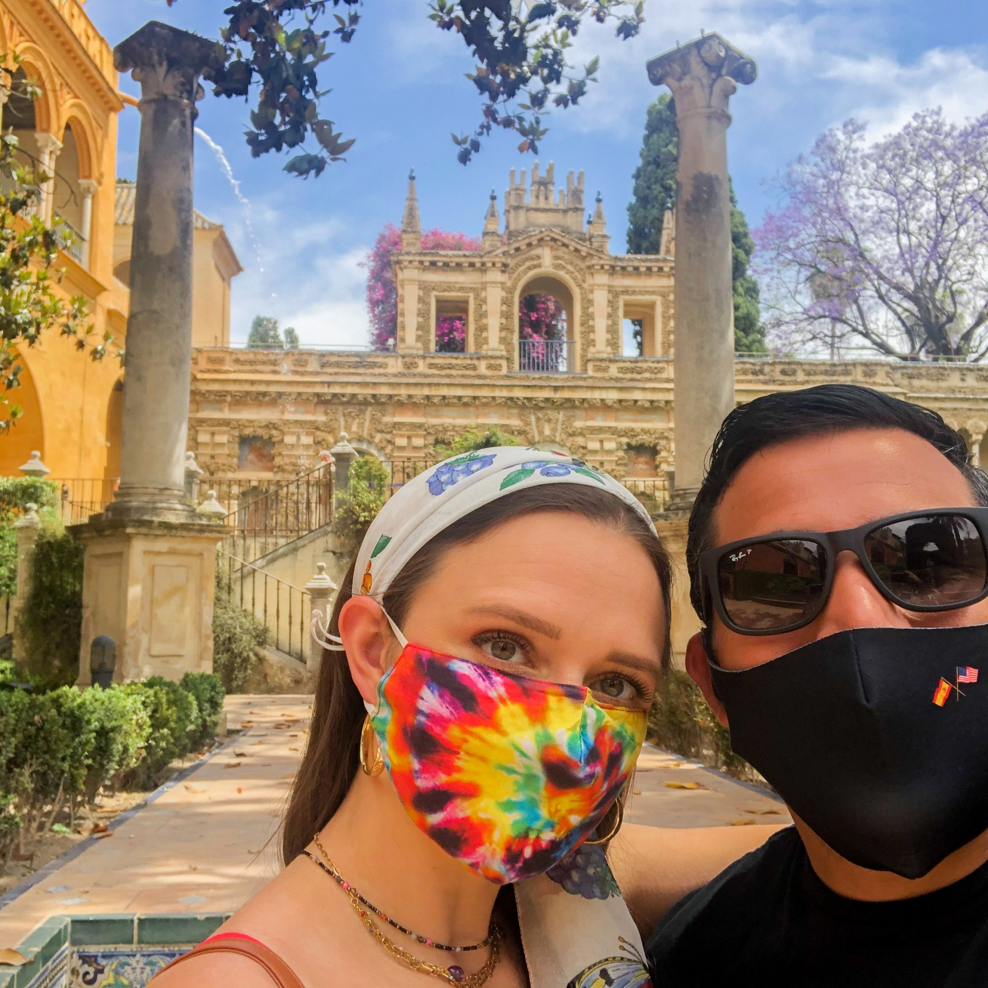A couple taking a selfie in the gardens of the Alcazar